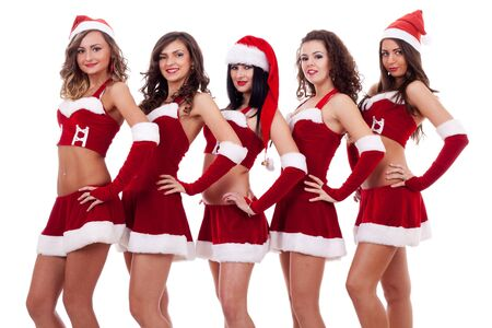 five young sexy Santa women isolated on white  photo