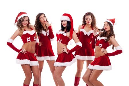 group of santa women  on a white background  photo