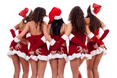 Gruppe von sexy junge Santa Frauen greifen ihre Esel auf weißem Hintergrund