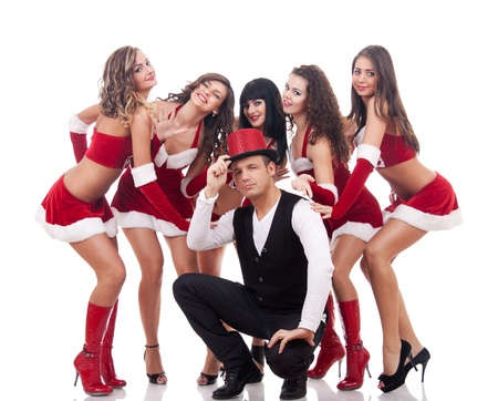 santa clause hat: group of santa women with a young man over white