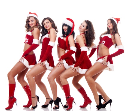 sexy hands: group of santa women showing their sexy legs  on a white background Stock Photo