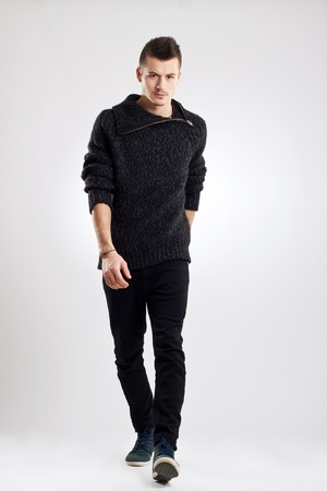 male fashion model wearing wool sweater, walking towards camera