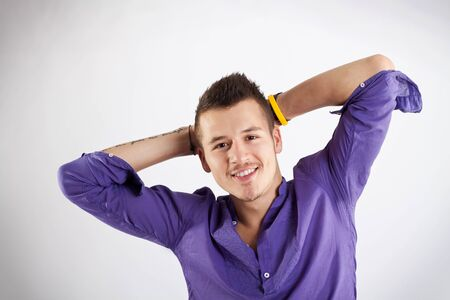 hands behind back: smiling casual man relaxing with hands behind back  Stock Photo