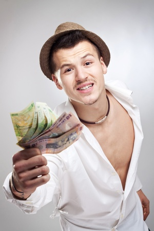 cool boys: young player wannabe showing a bunch of money to the camera Stock Photo