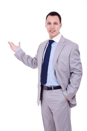 Happy young business man inviting you over a white background Stock Photo - 10933664