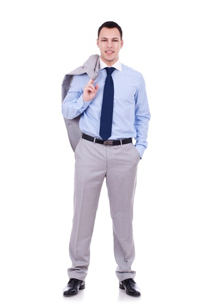 over shoulders: Full length of a relaxed young business man holding coat over shoulders isolated on white background  Stock Photo