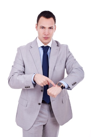 impatience: Business man impatiently pointing to his watch. Isolated on white.  Stock Photo