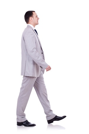 side job: portrait of a happy young business man walking on white background  Stock Photo