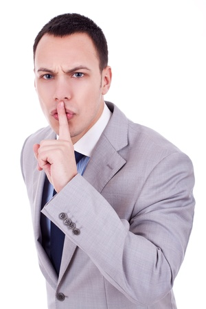 noiseless: Portrait of business man showing silence gesture with his forefinger by mouth