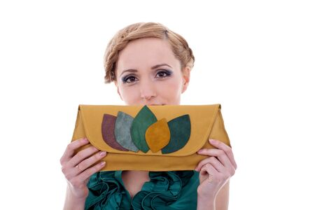 portrait of beautiful  girl holding a purse over her face photo