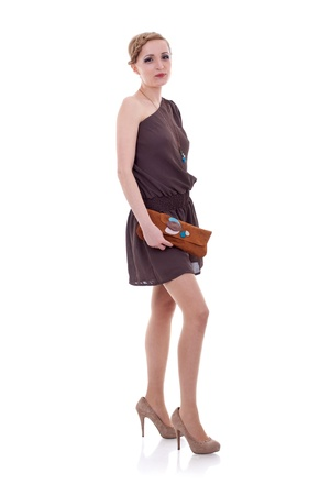 Studio portrait of a young woman with a purse isolated on white background  photo
