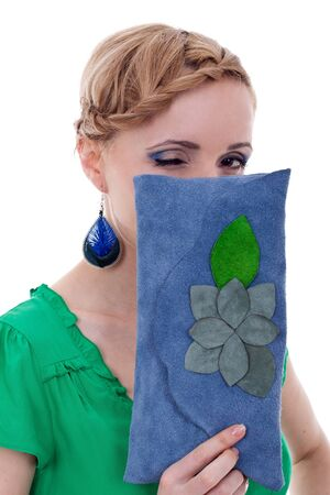 woman with nice earings and purse winking for the camera photo