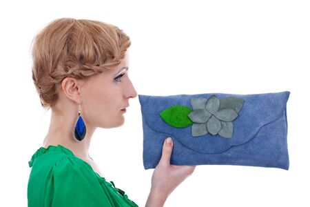 earings: profile picture of a beautiful woman wearing nice colorful earings and presenting a blue leather purse