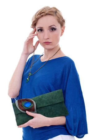approachable: Approachable woman holding purse and necklace against white background  Stock Photo