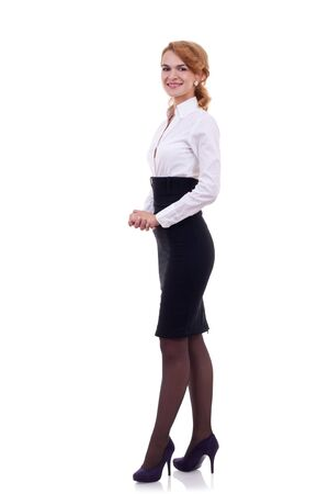 skirt suit:  Young Business woman  smiling isolated on a white background