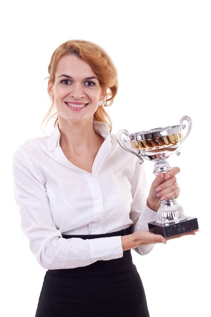 Portrait of a confident young business woman winning a silver cup against white background  photo