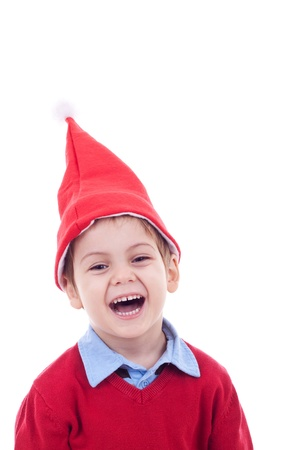 small boy in Christmas bonnet looks at camera, on white background photo