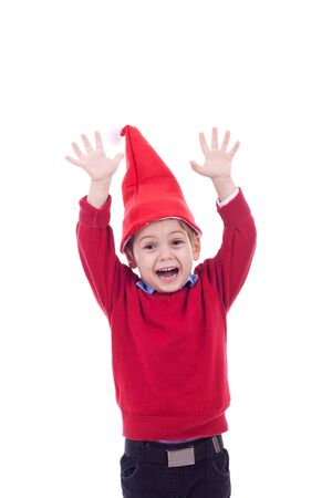 Happy boy in santa hat looking up, welcoming the christmas - isolated  photo