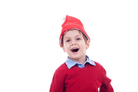 little santa boy wondering about what presents is he going to receive  photo
