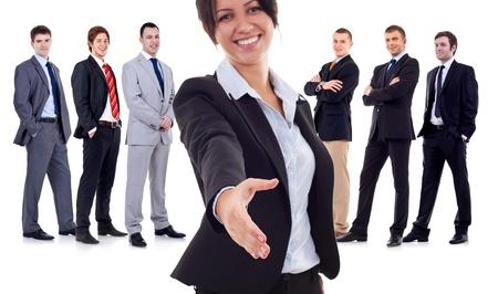 bienvenidos: mujer de negocios, dar la bienvenida a su equipo de negocios exitosos en blanco. Centrarse en la mano del l�der Foto de archivo