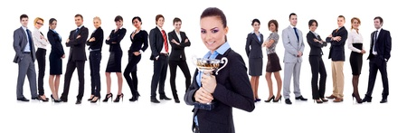 businessteam: winning businessteam with female executive holding a gold trophy