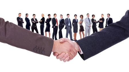 greet: handshakeof two businessmen  isolated on business background