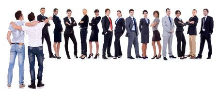 Young men pointint to the place they would like to be: THE BUSINESSTEAM! Stock Photo - 11188287