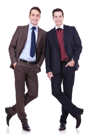 two friends: two business friends standing shoulder to shoulder and with their hands in pockets