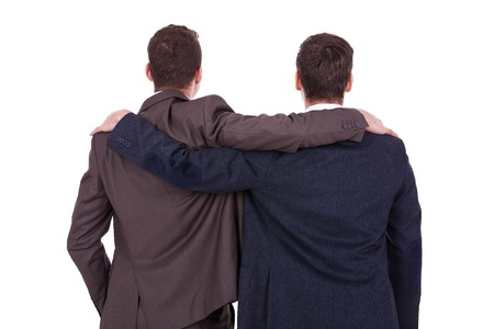 rear views: rear view of two young business men friends, over white background Stock Photo