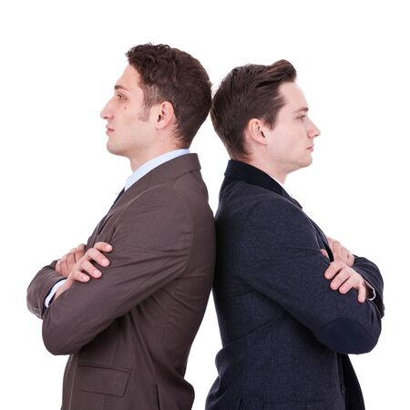 back to camera: back to back businessmen looking away from the camera over white background