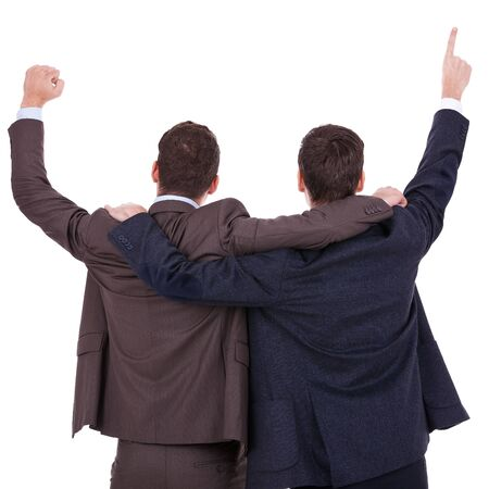 back to work: back view of two winning businessmen with their hands in the air over white background Stock Photo