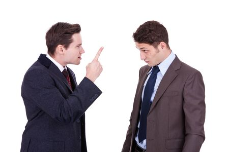 to argue: two young businessmen standing, discussing, arguing - isolated on white