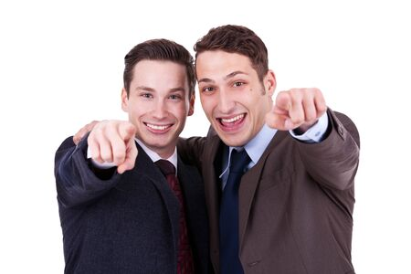 two happy businesss men pointing to you, over white background photo