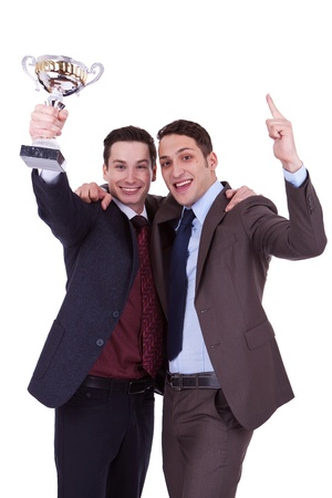 Two business men winning a trophy on white background photo