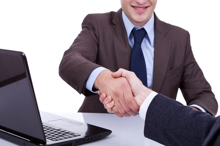 conclusion: Conclusion of job interview - two young men shaking hands Stock Photo