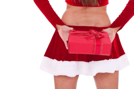 ass christmas: closeup picture of the back of a santa woman holding a present box