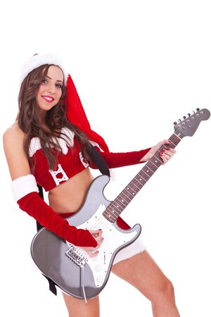 sexy santa playing an electric guitar  on white background photo