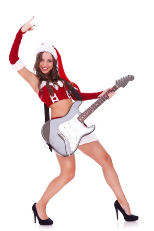 santa playing a guitar and making a rock and roll gesture on white background