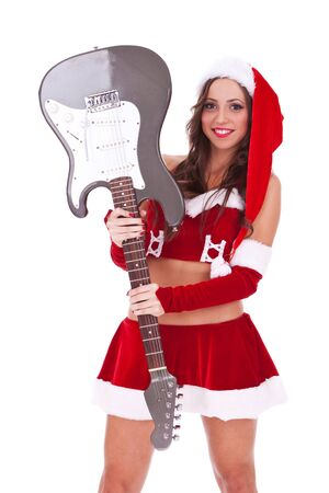 sexy santa holding an electric guitar near her head, on white background photo