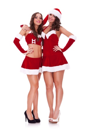 two sexy santa women hugging friendly on white background photo