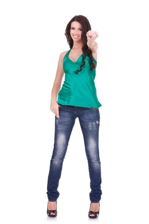 Full body young woman in casual clothes, pointing at you, isolated over a white background.  Stock Photo - 11317526