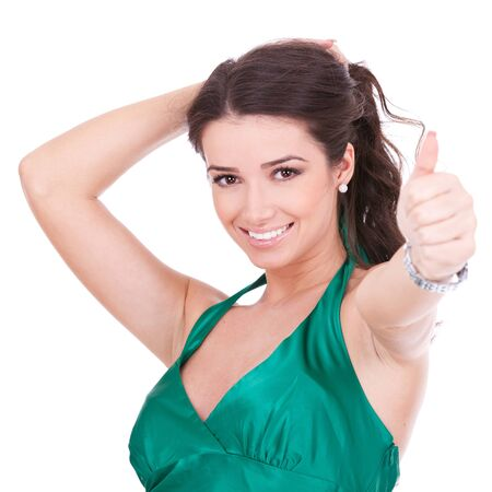 thumbs up woman: young casual woman giving the ok for something, on white background