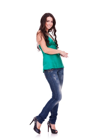 Full body young woman in casual clothes posing for the camera over white photo