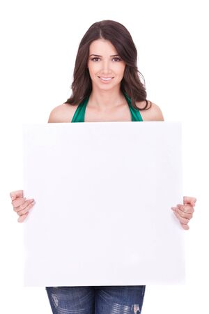 notice: casual woman displaying a banner ad isolated over a white background  Stock Photo