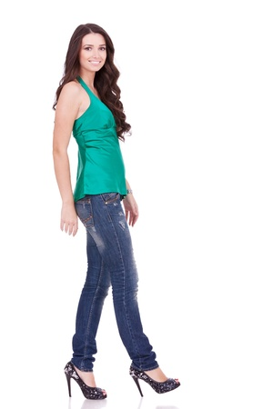 modeling: side view of a young casual woman walking on white background Stock Photo