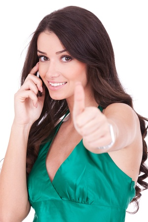Happy casual woman with phone and ok gesture, isolated  photo