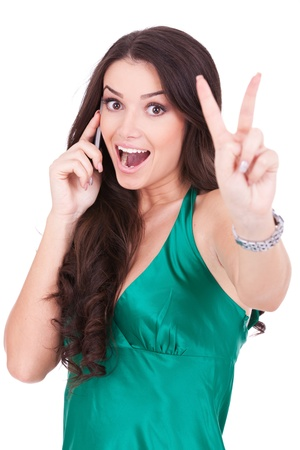 Happy casual woman with phone and victory gesture, isolated photo