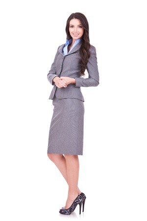 business woman standing: Full length portrait of a confident young business woman standing on white background