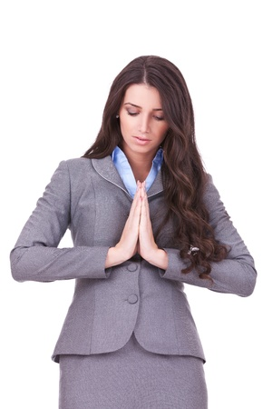 thoughtful female with her hands by face in pray, over white background  photo