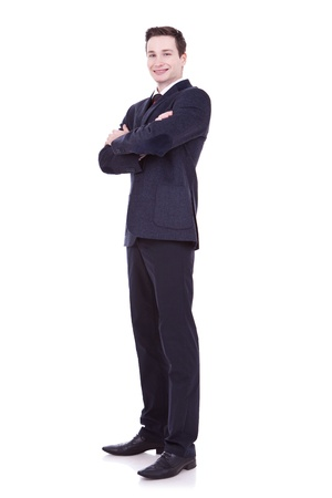 Full length of young business man standing with arms folded isolated on white background  photo